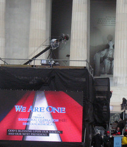 Abraham Lincoln oversees the set-up of a JumboTron.