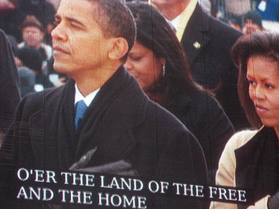 President-Elect Obama and Michelle Obama listen to the Star-Spangled Banner.