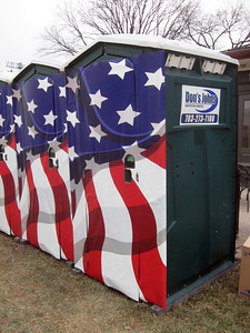 "Opening Day Ceremonies (Sunday, January 18, 2009) at the Lincoln Memorial:  ""Inaugural Port-o-Potties""--actually, ""Don's John's,"" to be precise, festooned with the stars and stripes, and positioned in the staging area behind the Lincoln Memorial."