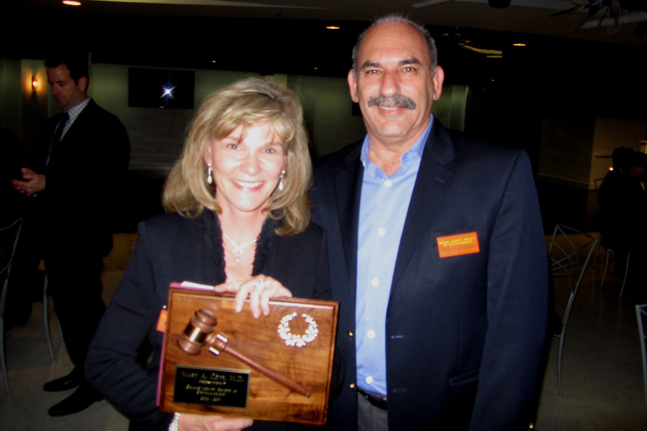Outgoing Pres Mary Cote and Barry Kupperman