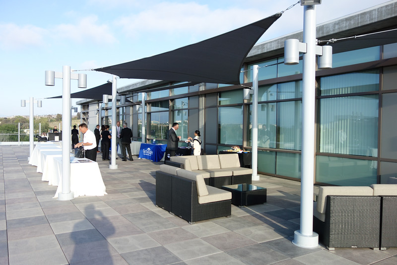 Reception held outdoors on rooftop balcony