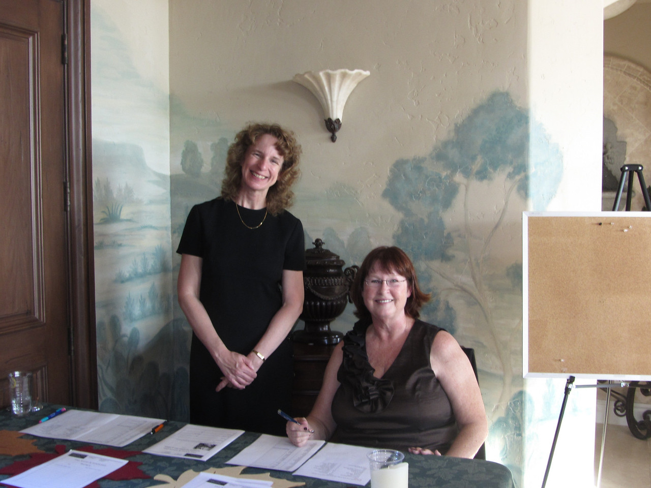 Sign-in desk with Holly Appelbaum and Donna McBride