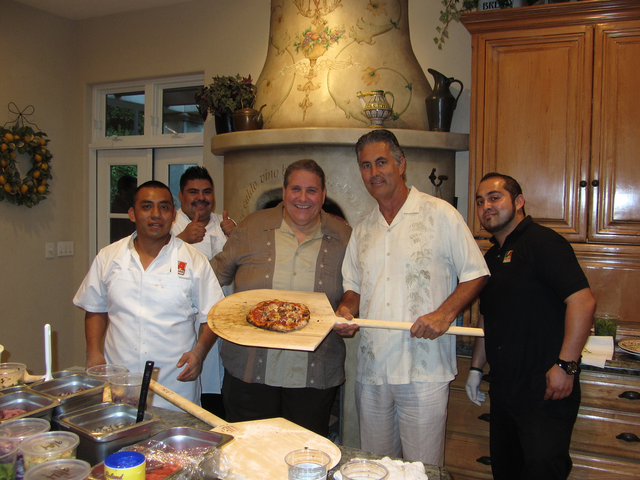 Former Rams Quarterback Vince Ferragamo posing with staff