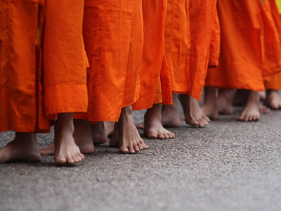 sometimes faces don't tell the whole story 300 monks doing the daily walk in Luang Prabang, Laos