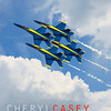 U.S. Navy Blue Angels Flight Demonstration Team Soaring Through Clouds