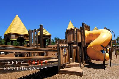 Well manicured playground under pretty blue sky