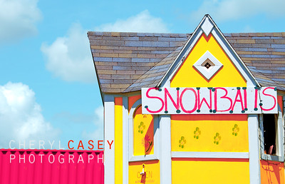 Colorful snowball shack under pretty sky