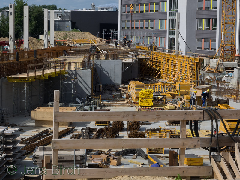 The Swedish Materials Science beamline at Petra III in the making.<br /> <br /> The X-Ray beam will originate from two electron undulators located underneath the pile of dirt that is seen in front of the black wall of the present Petra III building in the far back. <br /> The X-Rays will then come out of the electron tunnel right along the yellow structure that is standing next to the crane fundament to the right and and it will shine about 100 m through the beamline's various optical and experimental hutches.<br /> <br /> With this Sweden has the possibility to strengthen our materials research, both academic and in industry.<br /> <br /> Researchers from Linköpings universitet has an important role to play in defining what kind of experiments that will be possible here in the future<br /> <br />  © Jens Birch