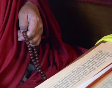 Bhutan is a county of predominately Buddhist, and prayer beads can be found in the hands of the faithful. This Monk was busy reciting prayer in a temple.