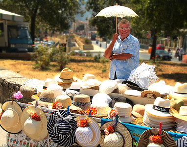 This hat salesman was in the city of Palermo, Italy, beside the Palatine Chapel. Just thought this was a cool point of view.