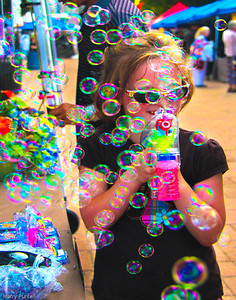 While visiting Cousin Lee in Louisville we enjoyed a downtown festival. Just happened to catch this young girl using a handheld bubble machine to make her day.