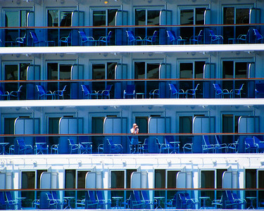 "Granddaughter Noelle took this photo of a cruise ship parked next to our ship. She titled it ""looking for Waldo"" It won first place in Photographer under age 15"