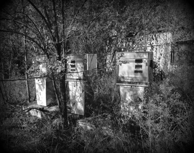 A black & white entry for Judi. Very much abandoned filling station.