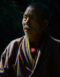 Local village elder in traditional garb, Uygen Choling, Bhutan