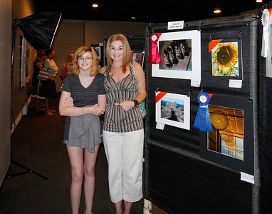 Granddaughter Sydney and (mom) Leanne by the winning photos for youth under age 16. A first and second place!
