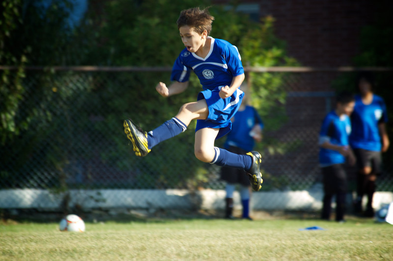 Casey celebrates after scoring a goal.  I think we all were smiling more than him!
