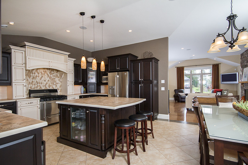5 lights were used in this image to allow matching to ambient exterior light conditions. Elevation above the countertops is critical in kitchen images.