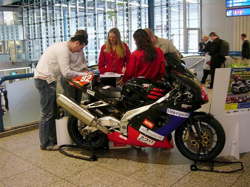 Our booth babes doing their job: giving away VIP tickets to the Ducati Clubraces Races in Assen on May 26th...