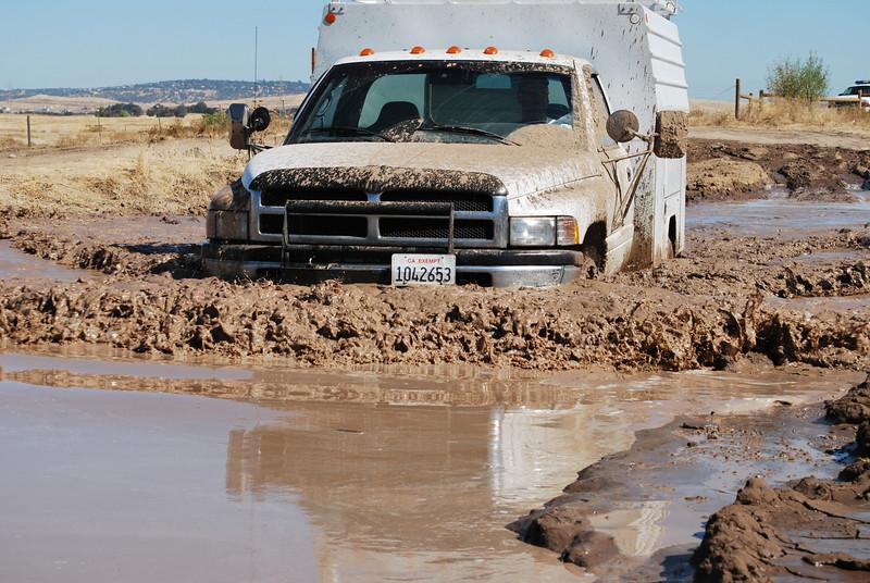 Chris is having fun in the mud.