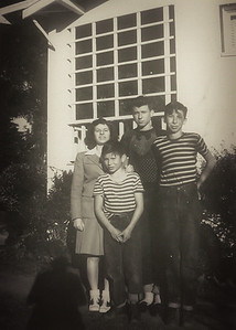 Lorraine, Bob, Angelo, and Buck. early 1940s. The west side of the ranchhouse.