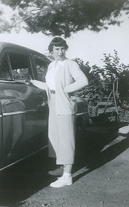 Lorraine with a 1946 Dodge. SE corner of the house. Gas pump in the background. Late 1940s