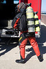 CFD Scuba Team member getting ready for rescue attempt in Lake Michigan. Large bottle in the main oxygen supplu. The smaller one, called a pony, is redundant, a back-up in cace the first tank fails.