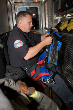 High Angle Rescue:<br /> One of various tasks the squads are trained for. Here Squad 5 fireman Pat Noonan puttung on Class 3 harness.