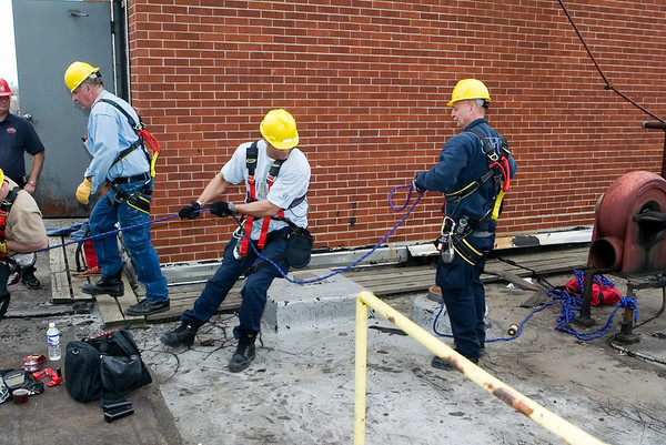 Special Ops support group<br /> Bring up the rescuers...<br /> The ascent up a 60 ft. silo is achieved with an ingenious system of ropes and pulleys among many other things. The weight of a man is thus cut by 2/3. Here CFD Squad 1 Firemen: at left stepping over plank Bob McCrea, pulling the rope, Tony Budvaitis, and to the right, Special Operations Chief Mike Fox are doing the pulling. This, as part of a drill in a week-long class.<br /> conducted by the University of Illinois Fire Services institute (IFSI), April 10-14, '06.