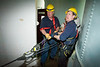 "CFD Squad 1 firemen John Scheurich ('Scooter""), and Bob McCrea manning rope and pulley system used to raise and lower firemen in a silo for a confined space rescue drill in class given by Illinois Fire service Institute, April 10-14, '06."