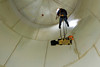 "Confined Space Rescue<br /> CFD Squad 7 Engineer Ron Zymali being lowered with what is known as a ""halfback harness"" used to hoist victim, in this case a 175 lb. mannequin, in ""Confined Space Rescue"" class conducted by the U. I. Il. Fire Service Institute April 10-14, '06."
