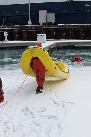 Squad 1 ice rescue drill. See nexr photo for explantion of rubber boat.