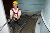 Anchoring the system<br /> CFD squad 1 fireman John Haring, manning rope and pulley system used to raise and lower firemen in a silo for a confined soace rescue drill in class given by Illinois Fire service Institute, April 10-14, '06.