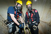 At the bottom<br /> Here, CFD Squad 1 firemen, John Scheurich (l) and Jim Stepien at the bottom of a 60ft silo during Special Operations drill run as part of a class conducted by the University of illinois Fire Services Institute April 10-14, '06. The object was to properly secure a 175 pound practice mannequin for simulated rescue.