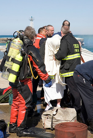 Successful rescue of man who jumped off the Montrose Harbor breakwater after his dog fell, or jumped in. A small portion of his left angle and shin are shown in their actual color, a rather bright pink.