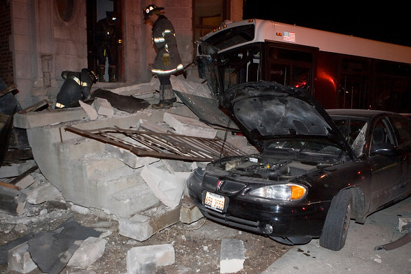 Car and bus into building on West Side.