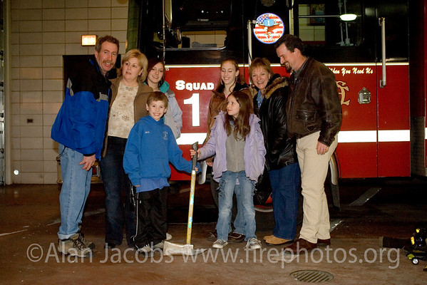 One of the best: Squad 1's Captain John Collins and family.