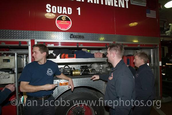Squad 1 boys repairing, l-r: Kelly Burns, John Scheurich on his back, Joe Kublk, and Pat MacCauley.