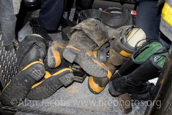 The End of an Era<br /> Time honored rubber pull-up boots taking thier last ride as the Squad went for thier new bunker gear and boots (extreme right).