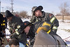Pin-in extrication 89th and Vincennes, 12/8/06<br /> Squad 5 Firemen Shun Jaynes (l), Tommy Meziere (center), and Corey Hojek (r)