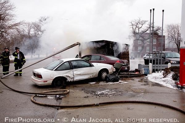 Two autos into newsstand, Garfield Blvd. & Ashland 3/3/07.