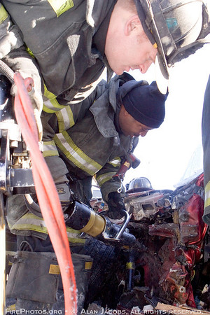 Pin-in extrication 89th and Vincennes, 12/8/06<br /> Squad 5 Firemen Tommy Meziere (top) and Shun Haynes and the Hurst Tool Cutter
