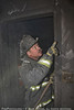 CFD Sq. 5 fireman Bobby Smith during overhaul pointing to more fire at still alarm 245 W. 107th
