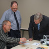 Mark Ruth, senior member of GIPSA's Board of Appeals and Review (BAR), explains to Sec. Tom Vilsack one of the training aids that the BAR has developed to achieve a high level of accuracy and consistency among graders throughout the Official Inspection System on October 23, 2013.  James Whalen, Chair of the Board of Appeals and Review, observes.  USDA photo by David Funk.