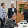 Mary Alonzo, Director of GIPSA's Technology and Science Division, and James Whalen, Chair of GIPSA's Board of Appeals and Review, explain the BAR's pivotal role in maintaining the accuracy and consistency of grain quality assessments in the U.S. grain industry to Sec. Tom Vilsack on October 24, 2013 as  Mark Ruth, senior member of the Board of Appeals and Review grades a sample of wheat. USDA photo by David Funk.