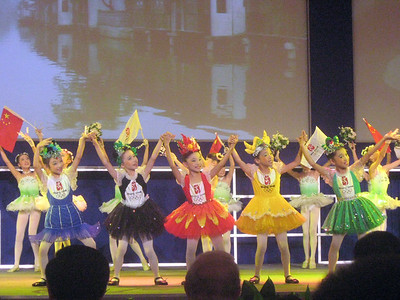 Children representing the five mascots of the Olympics