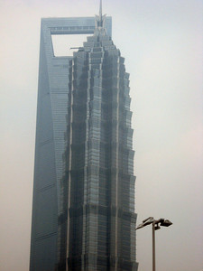 Time for seeing the sights!  The Jinmao Tower encases the Grand Hyatt between the 53rd and 87th floors--behind it is the still-under-construction Shanghai World Financial Center