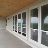 the back (concrete) deck and some kick-ass hurricane proof windows.<br /> (looking toward the master bedroom)