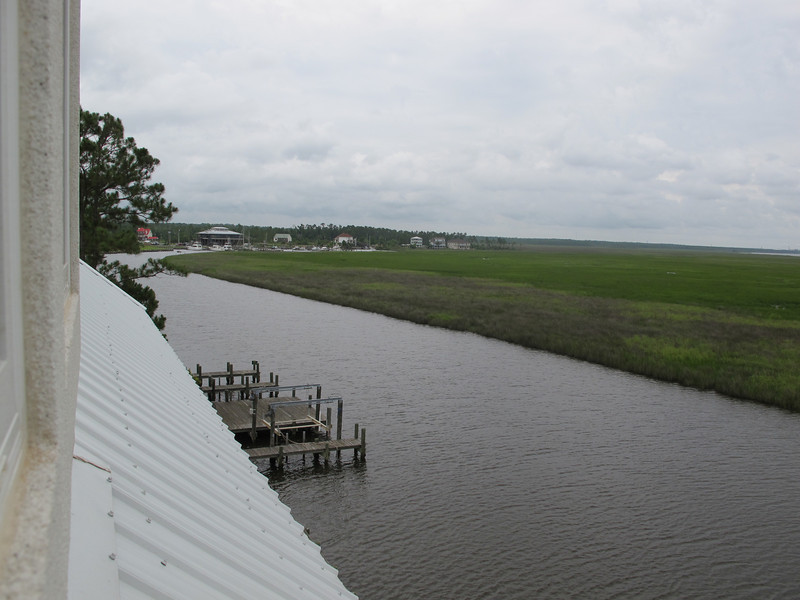 """A view from """"my"""" (the guest) bedroom. <br /> In case of fire, there's a short drop out the window, then a short skid on the roof, then a long fall against the dock."""