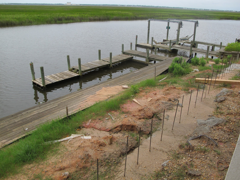 """The deck/boat slip the only thing that was Pre-K (""""pre-Katrina."""")<br /> The water rose so fast that there was not enough wave action to knock it out. (Only the houses!)"""