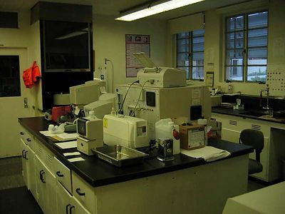 Hematology and processing sections of the lab. Island in picture shows electonic equipment including back of Cell Dyne Automated Hematology System. Ink Jet printer is on top of Cell Dyne.